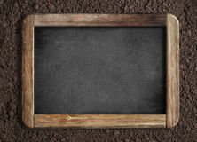 Blank chalkboard on soil background Stock Images