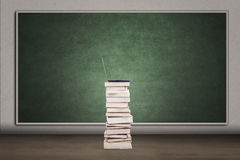 Blank chalkboard and stack of books Royalty Free Stock Photos