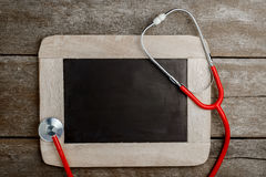 Blank chalkboard, stethoscope, health background concepts. Royalty Free Stock Images