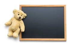 Blank chalkboard and teddy bear Stock Photo