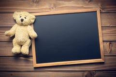 Blank chalkboard and teddy bear Royalty Free Stock Photo