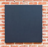 Blank chalkboard on wall Stock Photo