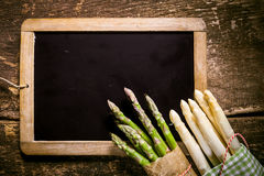 Free Blank Chalkboard With Asparagus On The Corner Royalty Free Stock Images - 53236539
