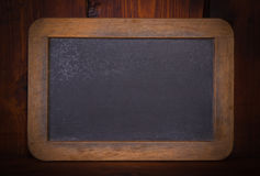 Blank chalkboard on wooden background Stock Photos