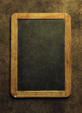 Blank chalkboard for your text. Top view over wooden table with Stock Photos