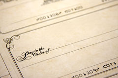 Blank Check. A blank check with the writing Pay to the Order Of Stock Photos