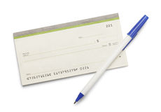 Checkbook Pen. Blank check book with pen isolated on a white background royalty free stock photos