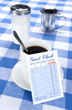 Blank check in diner. A breakfast and coffee setting in a cafe diner with a blank check for placement of copy stock images