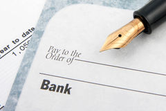 Blank check and fountain pen. Concept Royalty Free Stock Image