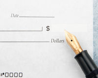 Blank check and fountain pen Stock Photos