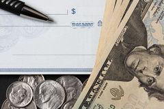 Blank check, pen and and money Stock Photos