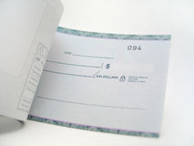 Blank Cheque. A blank cheque book being flipped through royalty free stock images