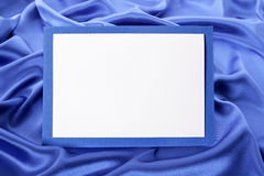 Blank Christmas or birthday greetings card or invitation with blue satin background, copy space. Blank greetings card or invitation with blue satin background stock image