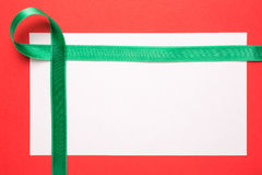 Blank Christmas card with green ribbon Stock Images