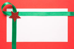 Blank Christmas card with green ribbon Royalty Free Stock Photo