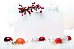 Blank christmas card and red baubles. Christmas card balls green red objects background Stock Photos
