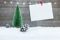 Blank christmas card with small fir tree on wooden background. Empty christmas card with small fir tree on wooden background Stock Images