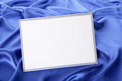 Blank Christmas greetings card or invitation with blue satin background Stock Photo