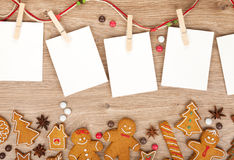 Blank christmas photo frames. With homemade gingerbread cookies Royalty Free Stock Image
