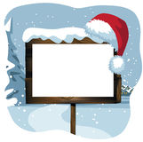 Blank Christmas sign in a snowy scene.  Royalty Free Stock Photography