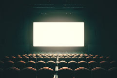 Blank cinema screen toning. Front view of cinema with blank screen. Toned image. Mock up, Ad concept, 3D Rendering Royalty Free Stock Image