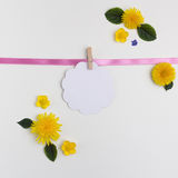 Blank circle. One note paper on white background. paper note hanging on ribbon, copy space for your text. Stock Photos