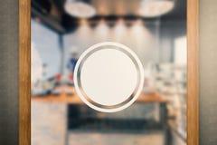 Blank circular sign on glass door Stock Photos