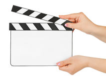 Blank clapboard in hands. Isolated on white background Stock Photo