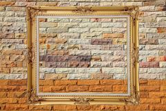 Blank classic frame on colorful brickwall Stock Photo
