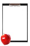 Blank clipboard with apple Royalty Free Stock Photo