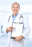 Blank clipboard hold by doctor Stock Image