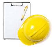 Blank clipboard paper and hard hat Stock Images