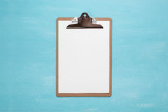 Blank clipboard on pastel blue color background with copy space, minimal style, flat lay Stock Image