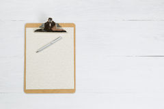 Blank clipboard and silver pen on white desktop Royalty Free Stock Photography