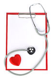 Blank clipboard with stethoscope Stock Photos