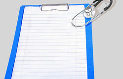 Blank Clipboard With Stethoscope. Isolated on gray background Royalty Free Stock Images