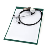 Blank clipboard with stethoscope on white Royalty Free Stock Photo