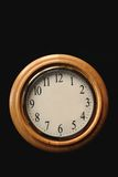 Blank Clock. Clock on a black background with hands missing Stock Image