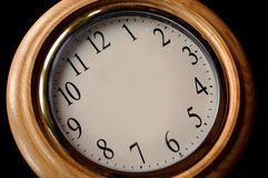 Blank Clock at Angle. Clock on a black background with hands missing Royalty Free Stock Images