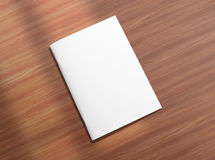 Blank closed brochure on wooden background Stock Image