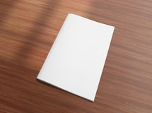 Blank closed brochure on wooden background Royalty Free Stock Images