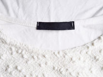 Blank cloth label. In white t-shirt royalty free stock images