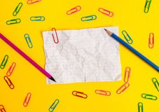 Blank colored crushed paper sheet clips pencils holders light background. Empty notes important future events stationary stock photos
