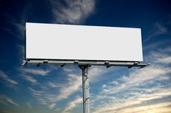 Blank commercial billboard. Against cloudy sky royalty free stock photo