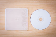 Blank compact disc with cover on wood Royalty Free Stock Images