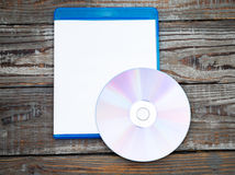 Blank compact disc with cover on wood background Royalty Free Stock Photo