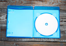 Blank compact disc with cover on wood background Stock Images