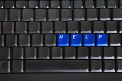 Blank computer keyboard with blue keys HELP. Concept of blank computer keyboard with blue keys HELP Royalty Free Stock Images