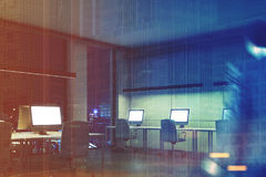 Blank computer screens in night office, men toned Royalty Free Stock Photos