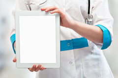 Blank computer tablet in the hands of doctor Royalty Free Stock Photos